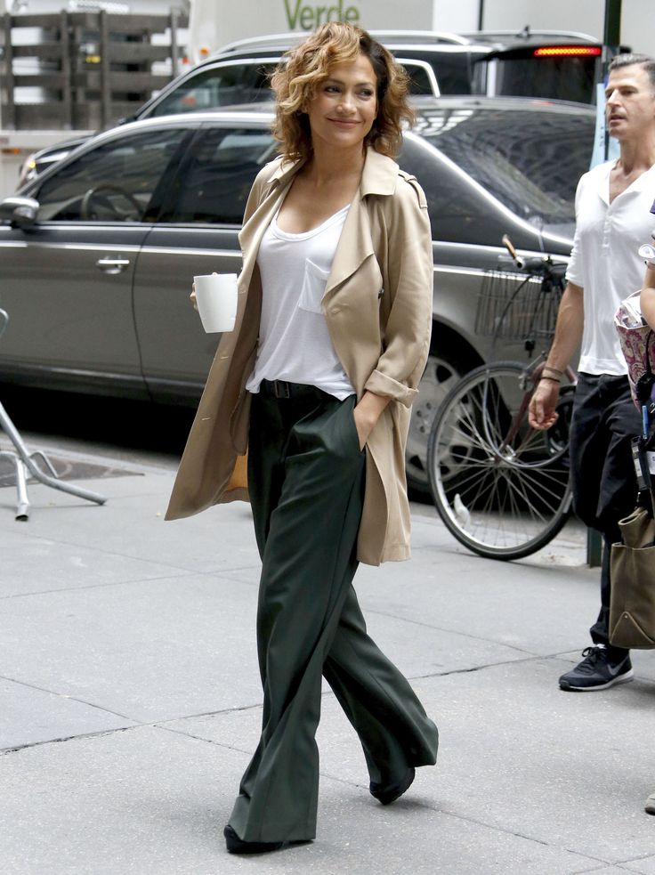 "Jennifer Lopez enjoys a cup of coffee on the set of her new TV show ""Shades of Blue"" in New York on July 15, 2015."