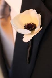 Single blush anemone boutonniere will look clean against his black-on-black suit