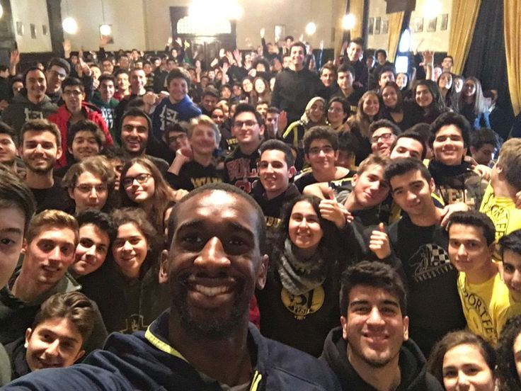 Basketball player Ekpe Udoh with schoolkids