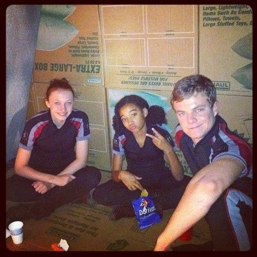 "When Rue threw up a peace sign, Doritos in hand. | 24 Times The Cast Of ""The Hunger Games"" Broke Character"