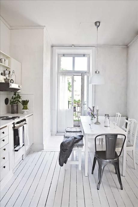 love everything about this: the white hardwood floors, the rustic white table, the glass cottage french doors, the lighting and kitchen cabinetry... ahhh