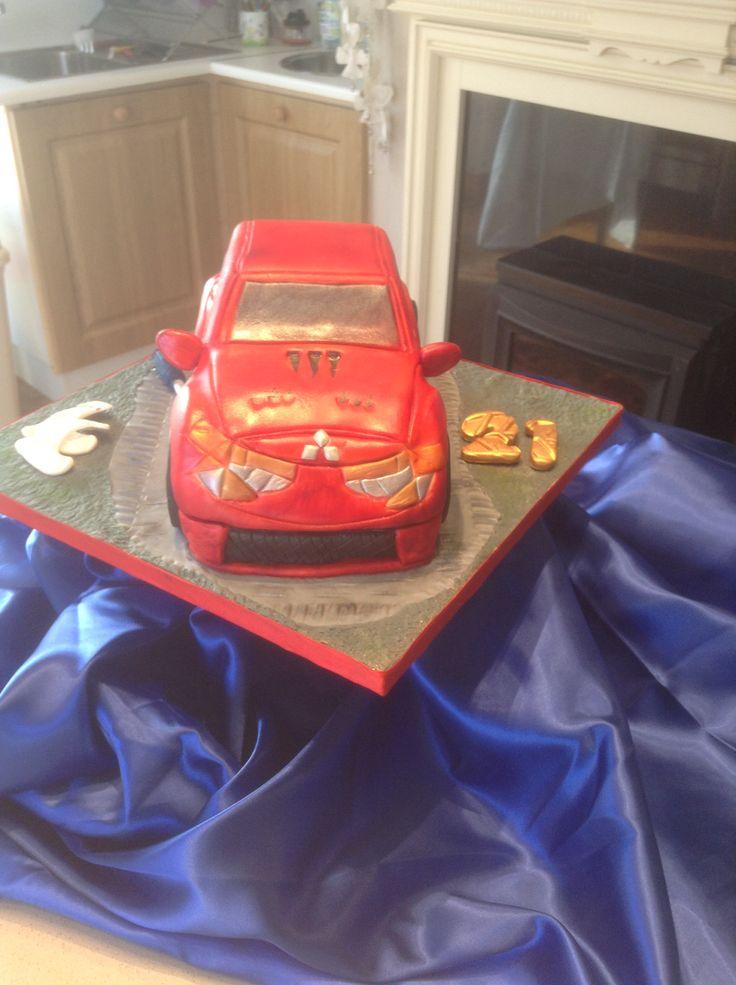 Chocolate carved red Mitsubishi car cake 21st birthday cake