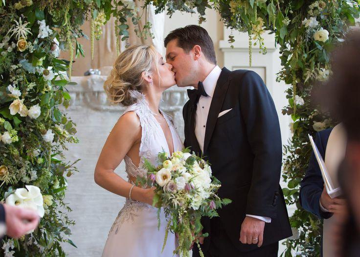 Wild flowing brides bouquet with boho flowing wedding arch Aynhoe Park Joanna Carter Wedding Flowers