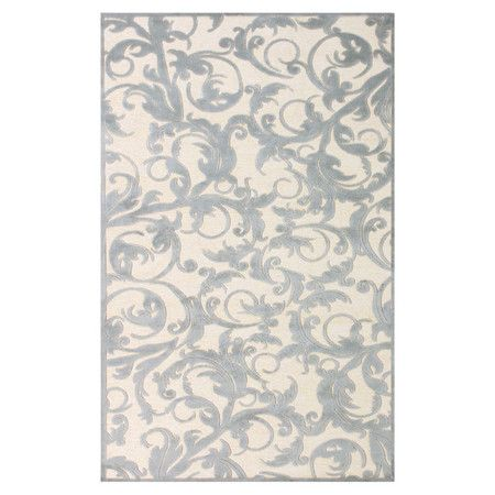 Scrolling acanthus leaves adorn this loomed art silk rug, an eye-catching addition to your den or living room decor.   Product: