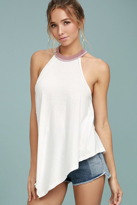 Be the definition of cool-girl-casual in this White Tank Top!
