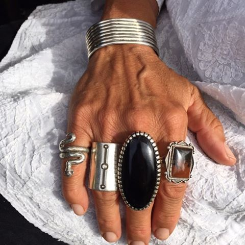 A lot going on in this excellent selection of jewellery. It's listed as: shield ring by Jennifer Curtis, large jet by AJ Platero, Tufa snake ring by Lester James, vintage petrified wood ring (!), vintage Navaho bracelet.