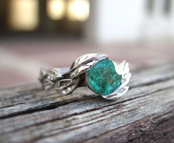 Exclusive to Benati!  Natural and floral leafs are holding this fine approx. 1 carat natural genuine green round brilliant cut emerald gemstone - A