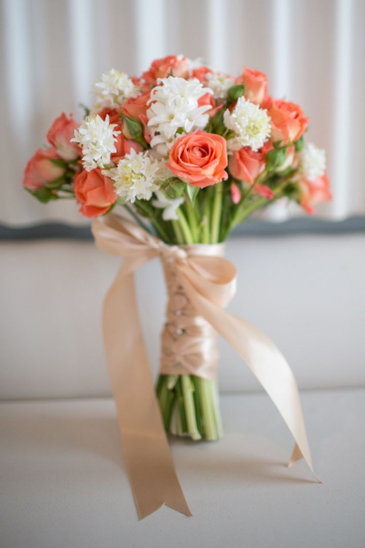 Orange and white bouquet // photo by http://www.alexisjuneweddings.com, see more: http://theeverylastdetail.com/2013/10/01/modern-nautical-peach-gray-wedding-inspiration/