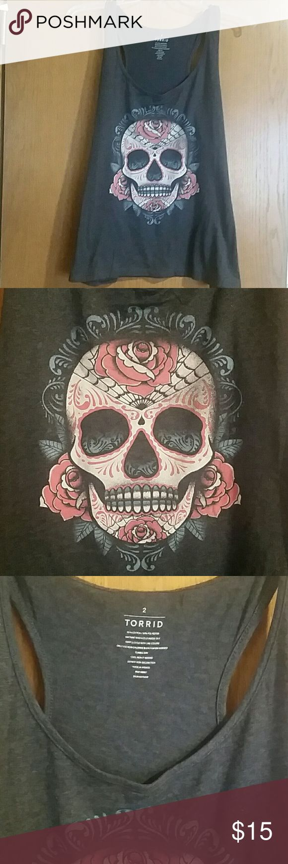 Torrid sugar skull tank top size 2 Torrid sugar skull tank top size 2.  Good pre-owned condition.  Grey with printed sugar skull design.  In good condition with no flaws or defects. torrid Tops Tank Tops