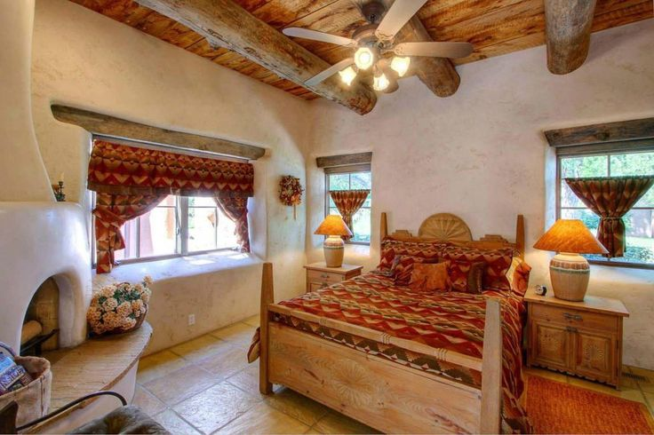 Eclectic Master Bedroom with Cement fireplace, Exposed beam, slate tile floors, Ceiling fan