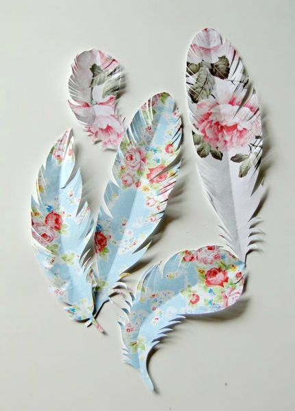 """Feathers"" cut from beautiful paper and attached to the end of a pen....nice!"