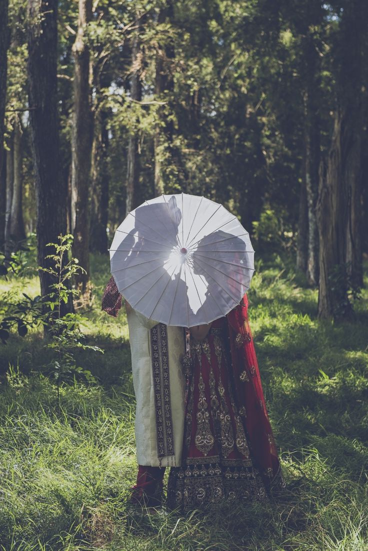 Cool use of the bridal umbrella. Photography by @One By Infinity www.onebyinfinity.co.nz