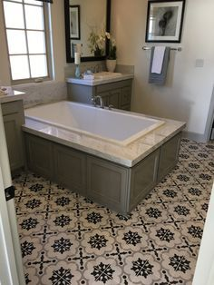 See this stunning bath, featuring our Cementine B/W 2 porcelain tile deco,