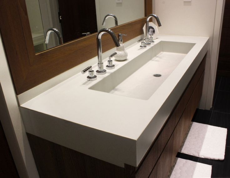 this is a custom concrete bathroom vanity sink for a bathroom by trueform concrete