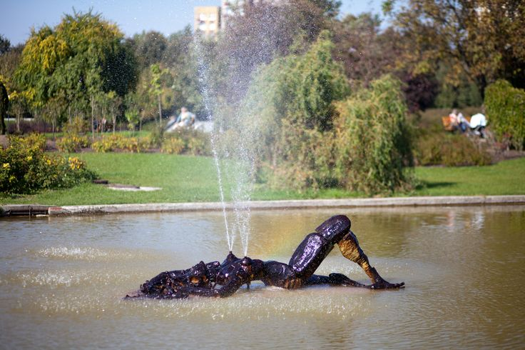 """Meet Sylwia: a sculpture-fountain made by Paweł Althamer together with Nowolipie Group. Sylwia lays in the pond inside """"The Garden of Eden""""."""