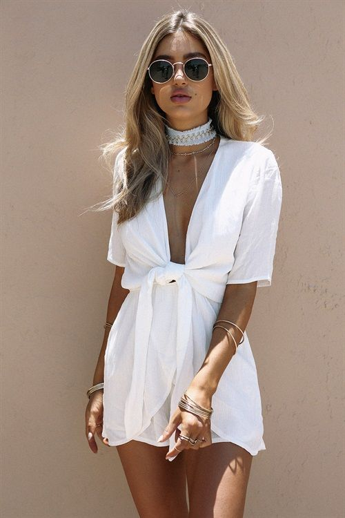 The cute and easy-to-wear Bisque Tie Playsuit is made from a crepe-feel fabric in an off white hue. It has draping overlay features on shorts, short sleeves, a plunging neckline and tie at centre front. Complete the look with round sunnies and a fine gold necklace! By Sabo Skirt.