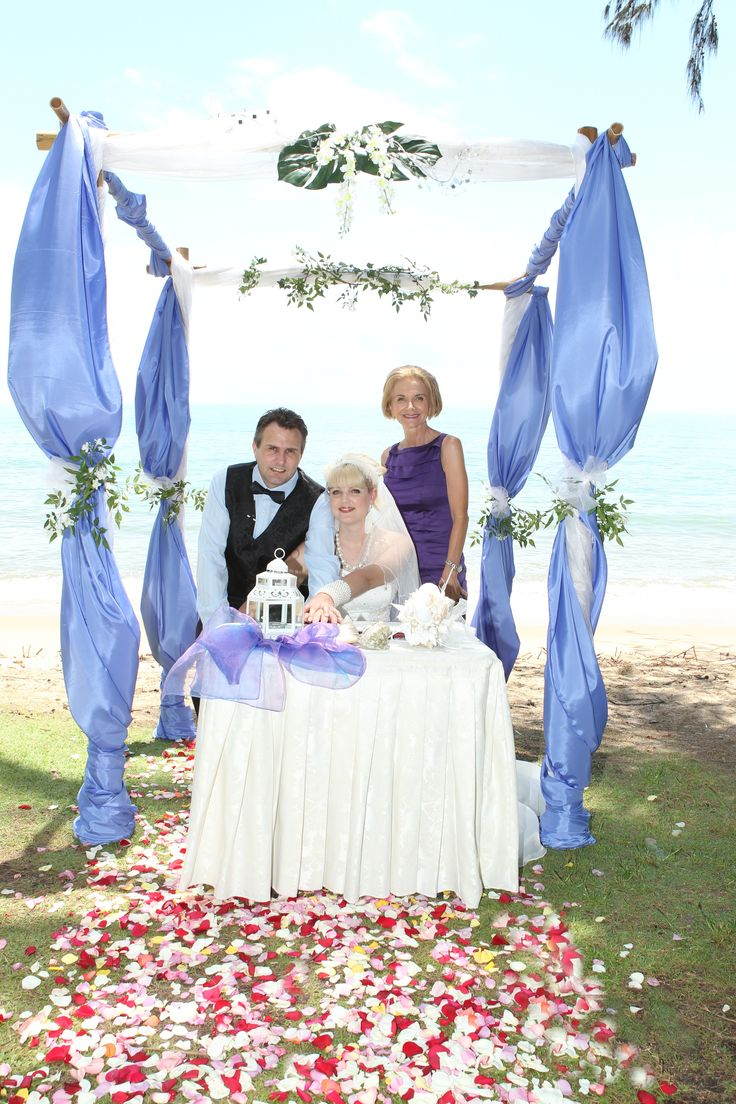Palm Cove Beach elopement from NSW with arbour and rose petals by barefeet weddings