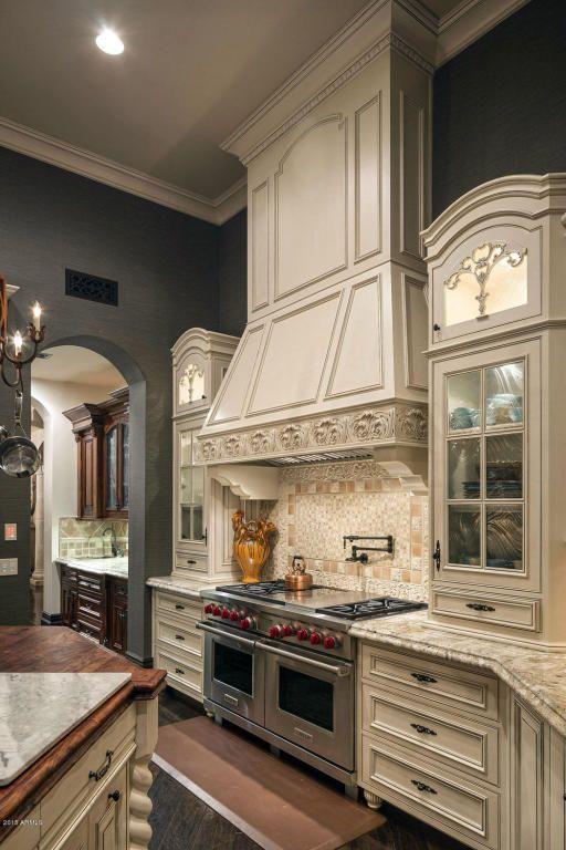 Traditional Kitchen with Limestone Tile, Custom hood, Crown molding, Inset cabinets, Hardwood floors, Raised panel, One-wall