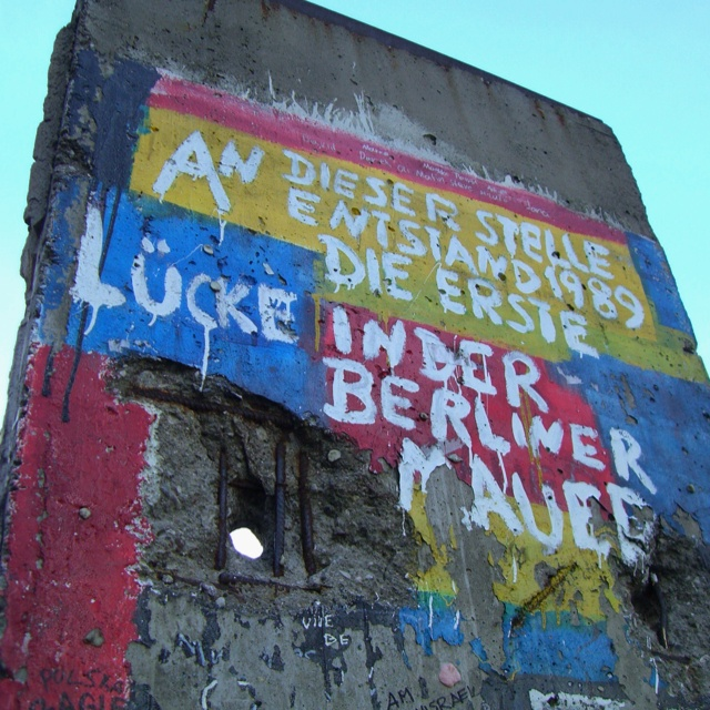 """Berliner Mauer.  It says: """"The first break in the Berlin Wall happened here in 1989"""""""