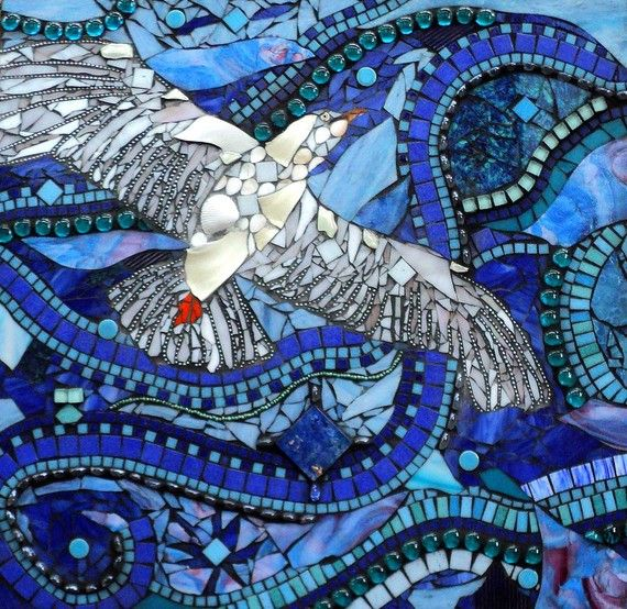 This is an amazing mosaic wall hanging made from broken glass, beads and various other objects.