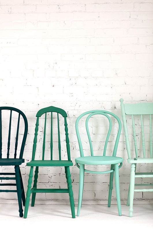 Get different wooden chairs from thrift stores and paint them all the same color / tones