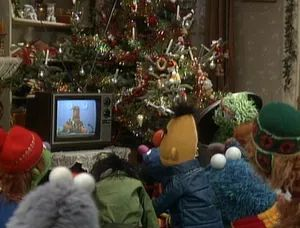A TV weather report from the Newsman announces an impending blizzard, causing Kermit to worry about Piggy.