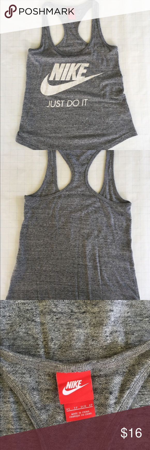 """NIKE tank top No tag but never been worn NIKE tank top! No flaws EXCEPT a NICK in the fabric of the """"E"""". You can't even tell!! Nike Tops Tank Tops"""