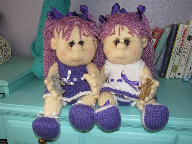 Twin knitted dolls.