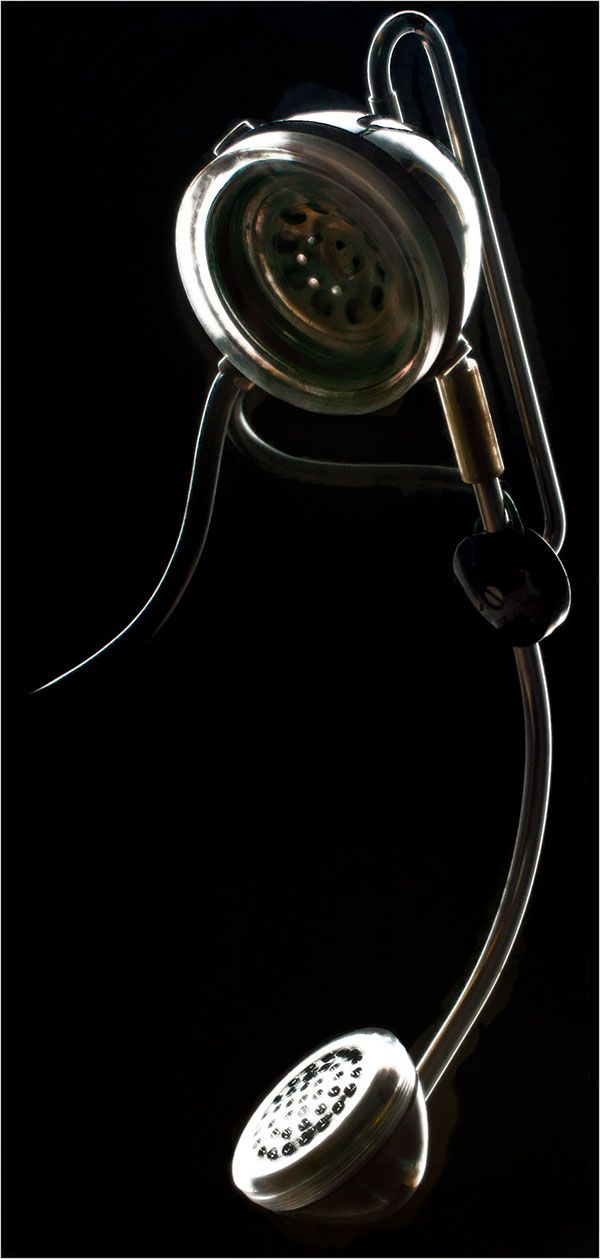 Dark field photo of vintage radio operator communications headset, circa 1955. This item was purchased from a salvage yard and was used at Los Alamos National Laboratory.