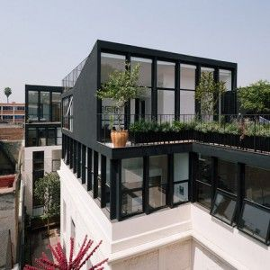 Angular black penthouses added to a 1920s building by Cadaval & Solà-Morales