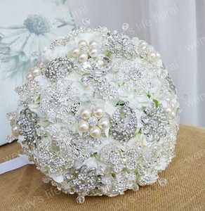 White hydrangeas with crystal brouches and pearls! So pretty!