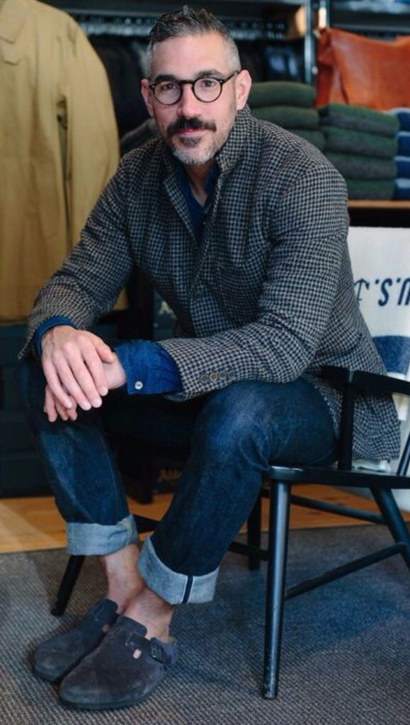 Todd Barket, The Owner of Unionmade Clothing in San Francisco, is wearing an Unstructured Wool Herringbone Blazer, Dark Denim Jeans, and Grey Suede Birkenstocks. Mens Fall Winter Fashion.