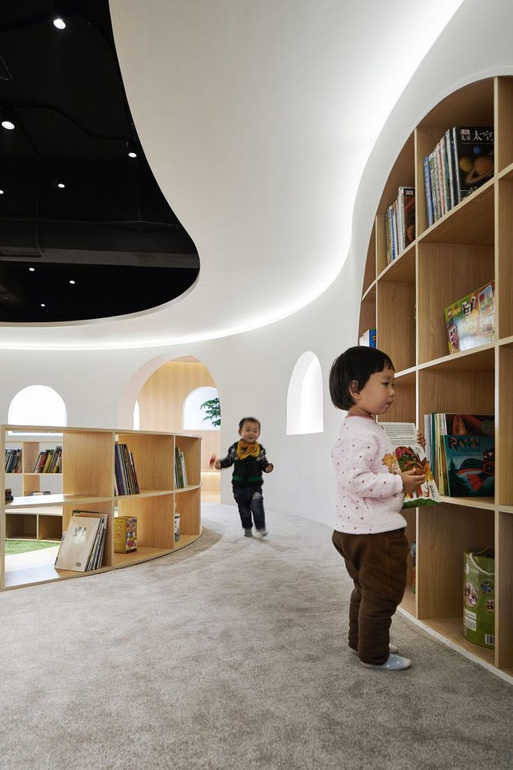 Curving wood-lined nooks create private reading spaces in Shanghai children's library