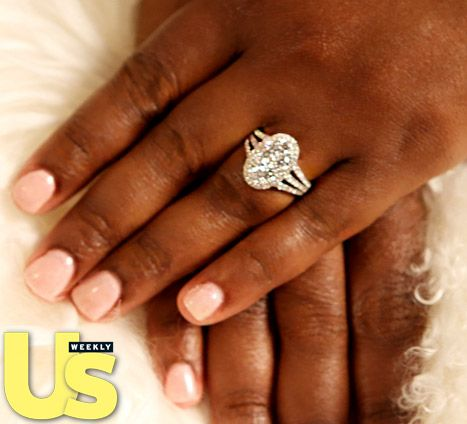 Kandi Burruss of Real Housewives of Atlanta fame shows off a gorgeous two-carat white diamond sparkler by ring designer Gregg Ruth.