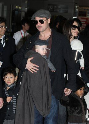 10 celeb baby wearing dads | BabyCenter Blog. Brad Pitt with son Knox, and wife Angelina Jolie