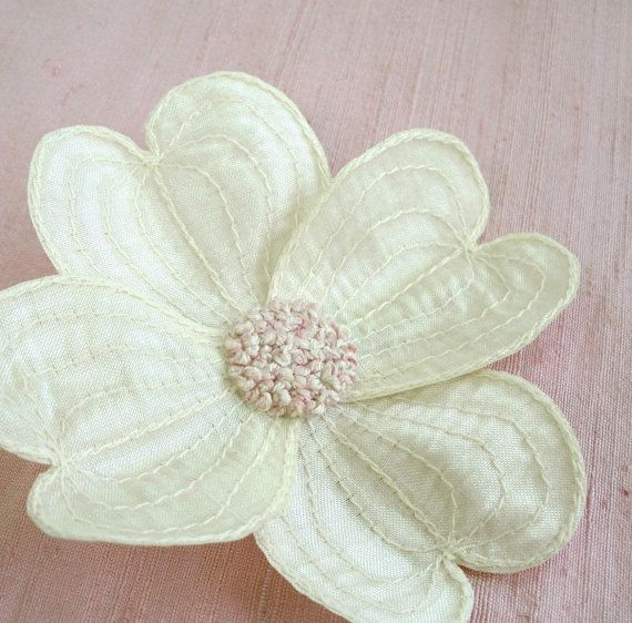 ack! dogwoods are the state tree of virginia, where i grew up, and therefore very dear to my heart. this would be a gorgeous hair accessory. $18.