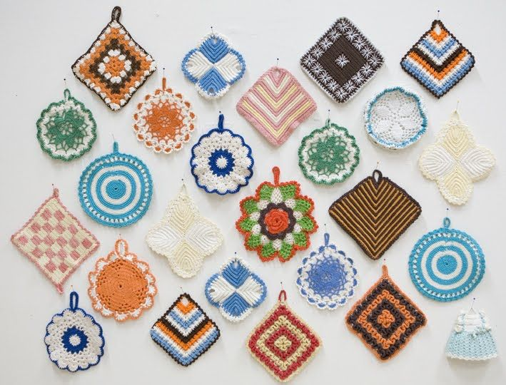 make a wall display with vintage crocheted pot holders - some uniformity