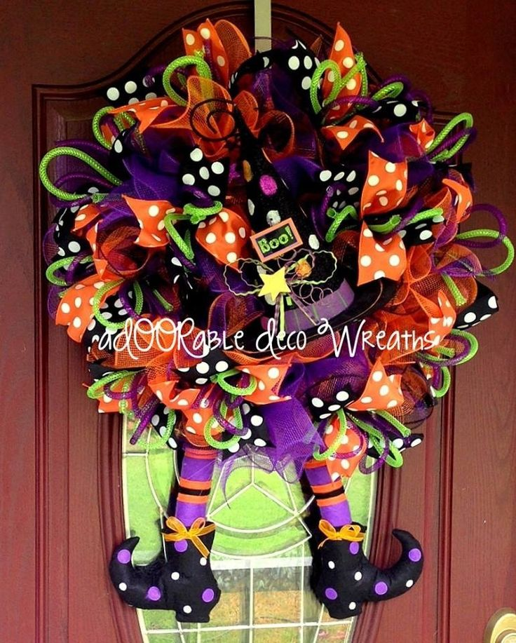 Wreath created by ADOORable Deco Wreaths This aDOORable Halloween Witch Wreath has Halloween all over it! www.facebook.com/ADOORableDecoWreaths Deco mesh, witch hat centerpiece and witch legs all purchased at www.trendytree.com. #trendytree #halloween