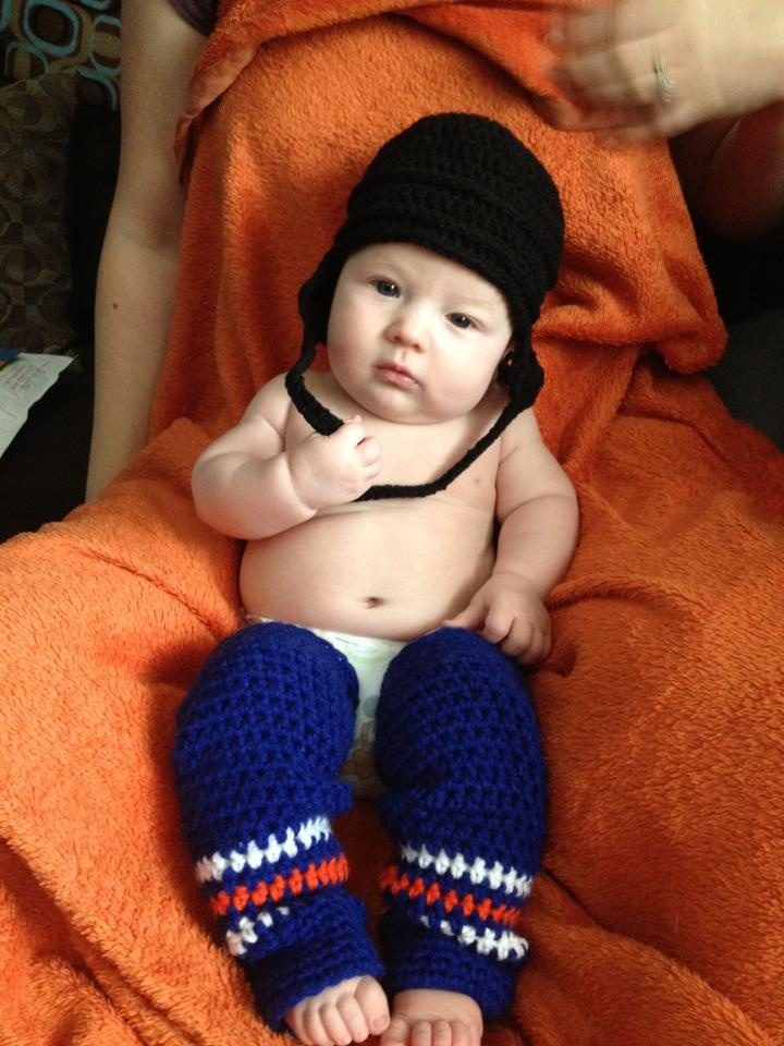 I know SOMEDAY my hockey loving nephew will have children eventually so I must pin this!! Crochet Hockey Helmet and Leg Warmers Pattern