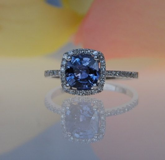 I <3 looking at this Etsy store. This is one of my current favorites.  1.5ct Cushion blue purple color change sapphire diamond ring 14k white gold engagement ring. $1,750.00, via Etsy.