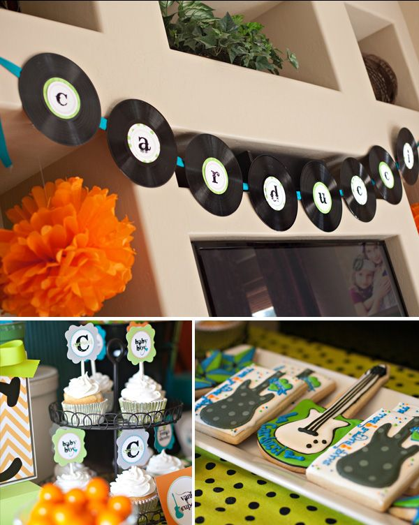 We used old records topped with my printable 4″ circle designs to create a banner for the front of the table, as well as a banner spelling out the baby's name.