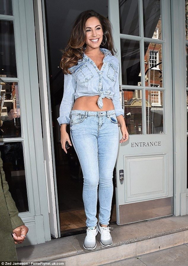 Delicious in denim: Kelly Brook looked amazing as she stepped out in London on Thursday in a striking double denim outfit which flashed her toned abs and ample cleavage together