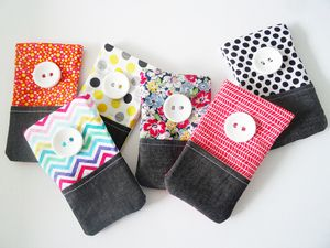 FlexiisMaterials: 100% cotton, denim, felt lining, big plastic button, internal metal flexing frameDimensions: approx 9cm x16cm (sizes may vary).New Flexii Pouchiis are bright, fun and all handmade from unique fabrics collected from all around Melbourne and around the world! Just flex the top, place your phone or other important things and off you go! These one of a kind Flexiis are available in all different colours, patterns, lined with double coloured felt, a handy lil front denim pocket…