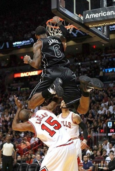 Dunk of the year! LeBron James dunks over John Lucas III from the Chicago Bulls