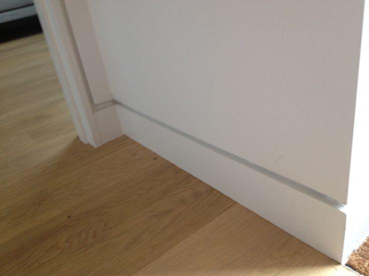 shadow gap modern skirting board (doesn't have to go around the door, could just end at the door frame)