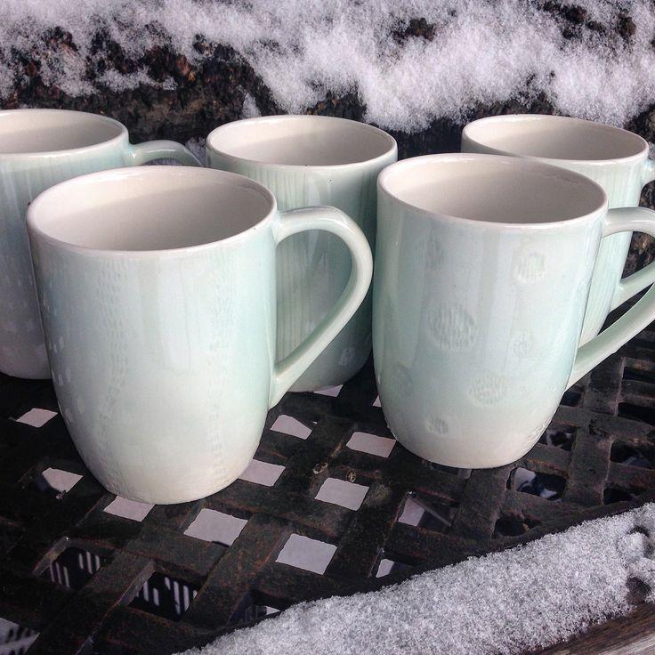 Handmade porcelain mugs with celadon glaze  made by Saara Paatero-Burtsov