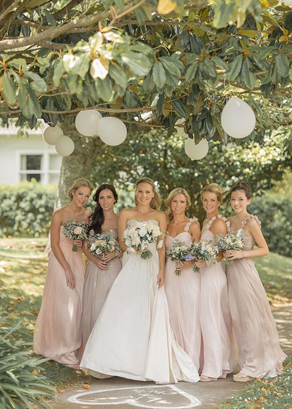 Blush pink and beige bridesmaid gowns....however the purple flowers aren't working for me.