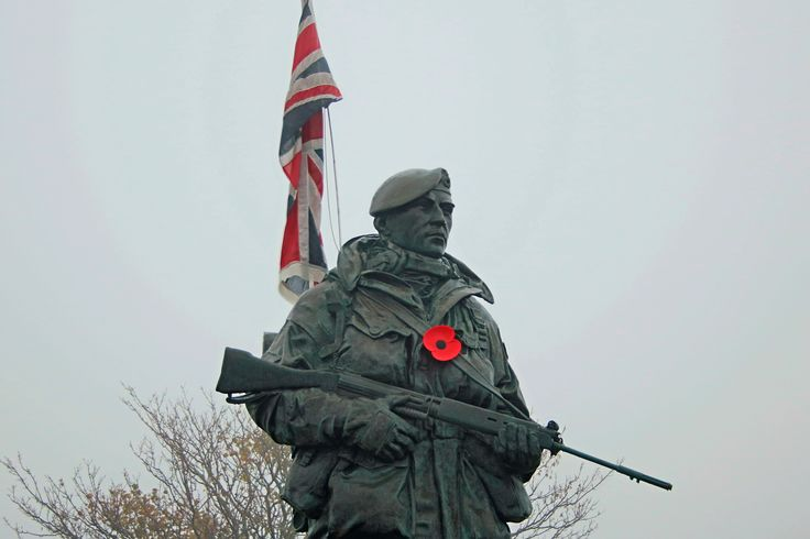 Royal Marine statue wearing a Rememberance Day poppy, Royal Marines Museum, Southsea.