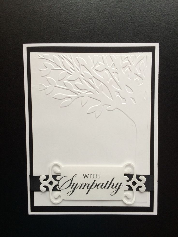 """Sympathy card using Spellbinders Fancy Tags die and """"With Sympathy""""clear stamp. 5x6.5"""" pre-made white card was layered with black card stock and white card stock embossed with Darice - Leafy Tree Trunk embossing folder. Black satin ribbon was used behind the label and tucked under the white card stock layer. Created by: Melanie Weise"""