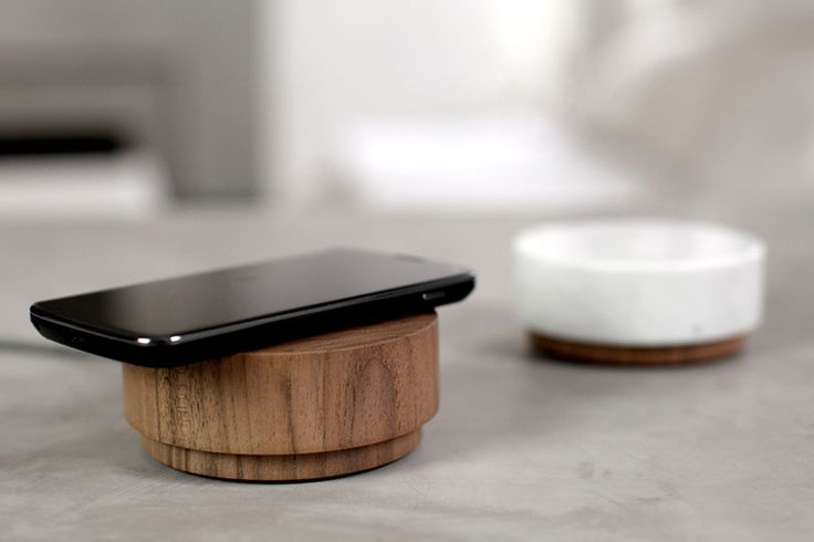 The Pebble uses the Qi inductive charging standard, which means any devices like Samsung Galaxy S4 and S5, Nexus 5 and 7, various Nokia Lumia and any phone that relies on Qi charging will work just fine. Simply rest the device on top and it will automatically begin wireless charging.